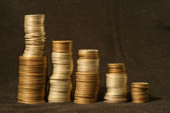 Coin graph. Business background: the graph with stacks of coins Royalty Free Stock Photo