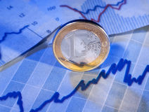 Coin and graph Royalty Free Stock Photography