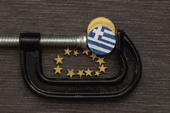 Greece coin is clamp pressure Royalty Free Stock Photos