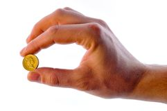 Coin in hand Stock Photos