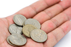 Coin in hand. Spending money to use in everyday life Royalty Free Stock Photography