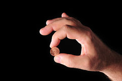 Coin in hand stock images