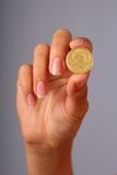 Coin in hand. Royalty Free Stock Image