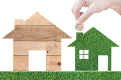 Coin Hand holding house icon in nature as symbol of mortgage Stock Photos