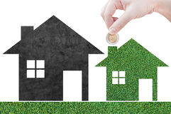 Coin Hand holding house icon in nature as symbol of mortgage Stock Image