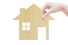 Coin Hand holding house icon in nature as symbol of mortgage,Dream house on nature background Royalty Free Stock Image