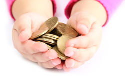 Coin. In the hands of a child holding a coin Royalty Free Stock Photography