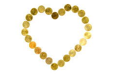 Coin heart. Heart shape made out of coins royalty free stock images