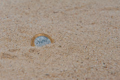 Coin In The Sand Stock Photo