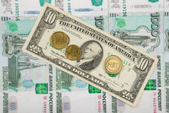 The coin with the inscription. `no` and the euro are on the bill of ten dollars which lies on a pile of thousand-Russian banknotes Stock Photos