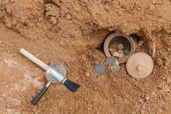 Coin in the jar. The concept of discovering treasures from underground Royalty Free Stock Photos