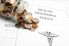 Coin jar and policy. Health-care policy and coin jar Royalty Free Stock Photo