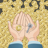 Coin and Key in hands - Bitcoin concept Stock Image