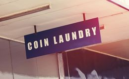Coin laundry sign closeup. Coin laundry sign close up Stock Photography
