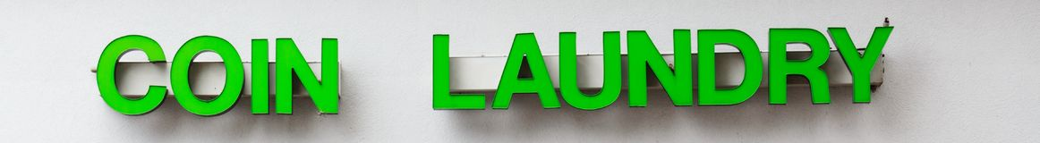 Coin Laundry Sign In Green Letters royalty free stock photos
