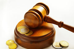 Coin law. Assorted euro coins and judges court gavel Royalty Free Stock Photos