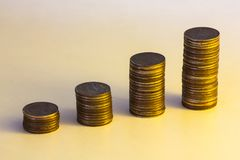 Coins and low light business investment concept Royalty Free Stock Photo