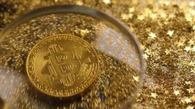 Coin Made As Virtual Currency against Shining Stars Macro. Macro coin made as virtual currency bitcoin based on block chain register against shining stars stock footage