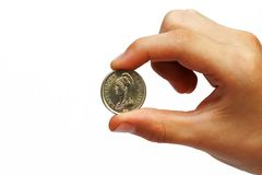 Coin in a man's hand. Photo of the coin in a man's hand on white background Royalty Free Stock Photos