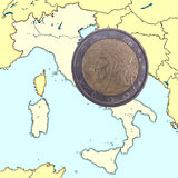 Coin on map italy Royalty Free Stock Photo