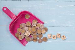 Coin or money in dust pan and wood text. `save ` on Royalty Free Stock Photos