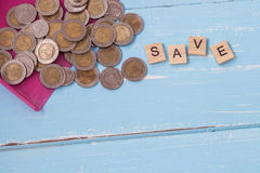 Coin or money in dust pan and wood text. `save ` on Royalty Free Stock Photo