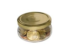 Coin money in glass jar. Close-up isolated on white background Stock Image