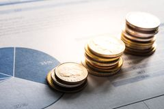 Coin money stacked growing on document graph. Financial concept Royalty Free Stock Photography