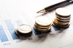 Coin money stacked growing with pen on document graph.financial. Concept Royalty Free Stock Photography
