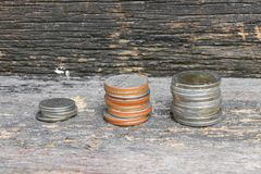 Coin money stacks  on wooden floor background.  Royalty Free Stock Image