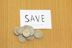Coin and the note with save Stock Image