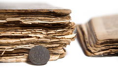 Coin and old books Royalty Free Stock Photos