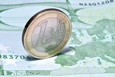 Coin one euro on the banknote of hundred euros Royalty Free Stock Photos