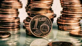 Coin one euro cent. Coin on a blurry background of coins. Curren Royalty Free Stock Photos