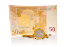 Coin one euro and fifty euro banknote Royalty Free Stock Images