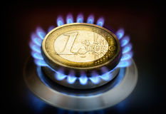 Coin one euro on a gas torch. Royalty Free Stock Image