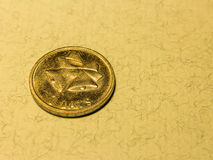 Coin one latvian lat with a bell on light background Stock Image