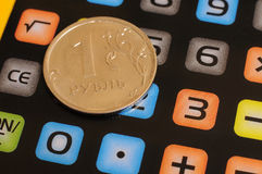 Coin one ruble and calculator Stock Photography