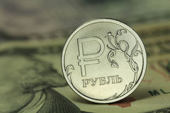 Coin in one Russian ruble on a background dollars Royalty Free Stock Photography