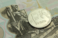 Coin in one Russian ruble banknote fifty rubles Royalty Free Stock Image