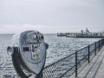 Coin Op Binoculars. Down by the sea - A coin operated view on the promenade at Saybrook Point, Old Saybrook, Connecticut, USA royalty free stock photos