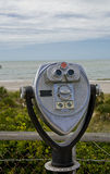 Coin-op Binoculars. Coin op binoculars with scenic beach vista in background at Fort Desoto in Florida Stock Photos
