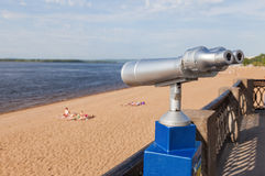 Coin operated binocular on the bank of river Stock Photo