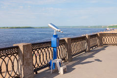 Coin operated binocular on the bank of river Royalty Free Stock Photos