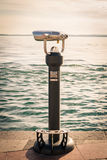 Coin Operated Binocular viewer next to the waterside promenade i Royalty Free Stock Photography