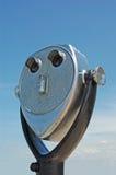 Coin operated binoculars. Binoculars shaped like funny face Royalty Free Stock Image