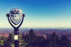 Coin-operated binoculars looking out over a mountain landscape. Coin-operated binoculars looking out over the Blue Ridge Moutains, NC stock photos