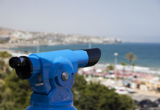 Coin operated binoculars overlooking the beach. Royalty Free Stock Image