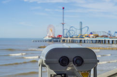 Binoculars overlooking beach in Galveston. Coin operated binoculars overlooking beach and pier in Galveston, Texas royalty free stock photography