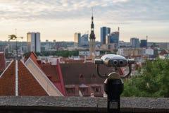 Coin-operated binoculars overlooking city Stock Photo